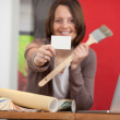 Stock Photo: Female interior designer showing white card