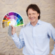Decorator with paint sample colours — Stock Photo
