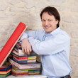 Stock Photo: Interior decorator with books of fabric samples