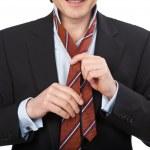 Man tying his tie — Stock Photo #27955127