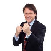 Smiling businessman balling his fists — Stock fotografie
