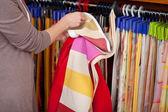 Customer looking at fabric samples — Stock Photo