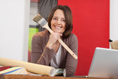 Woman working in an interior design shop — Stock Photo