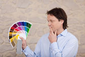 Man planning the colours of his new house — Stock Photo