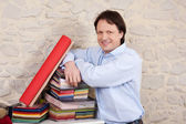 Interior decorator with books of fabric samples — Stock Photo