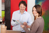 Interior decorator advising a customer — Stock Photo