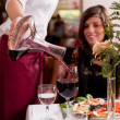 Serving red wine in a restaurant — Stock Photo #28118385
