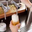 Stock Photo: Refreshing frothy pint of draft beer