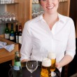 Waitress serving drinks in a bar — Stock Photo #28118831