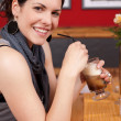 Attractive woman enjoying iced coffee — Stock Photo