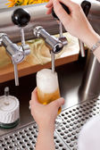 Refreshing frothy pint of draft beer — Stock Photo