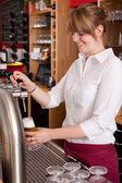 Pretty waitress serving draft beer — Stock Photo