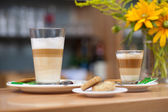 Two glasses of latte macchiato coffee — Stock Photo