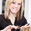 Trainee hairstylist cutting hair — Stock Photo