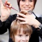 Cute little child getting a haircut — Stock Photo #28122429