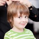 Adorable little boy getting a hair cut — Stock Photo #28122437