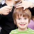 Beautiful young child at the hairdresser — Stock Photo