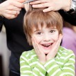 Cute young child at hairdresser — Stock Photo #28122661
