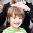 Young child in a hairdressing salon — Stock Photo