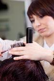 Hairstylist cutting hair — Stock Photo
