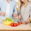 Couple Making Salad Together At Kitchen Counter — Stock Photo