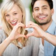 Stock Photo: Couple Forming Heart Shape With Hands
