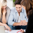 Financial Advisor Explaining Document To Couple At Table — Stock Photo #28149079