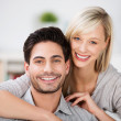 Stock Photo: Young couple with beautiful smiles