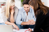 Financial Advisor Explaining Document To Couple At Table — Stock Photo