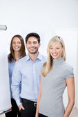 Smiling young team of businesspeople — Stock Photo