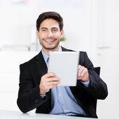 Businessman Holding Digital Tablet At Desk — Stock Photo