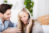 Woman Conversing On Cordless Phone While Man Looking At Her — Stock Photo