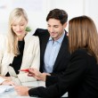 Stock Photo: Young couple with a business adviser