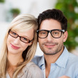 Stock Photo: Attractive young couple wearing glasses