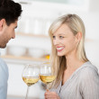 Couple Toasting Wine Glasses In Kitchen — Stock Photo