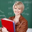 Vivacious female student with class notes — Stock Photo