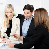 Young couple with a business adviser — Stock Photo