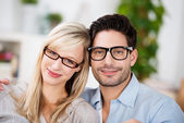 Attractive young couple wearing glasses — Stock Photo