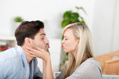 Couple Puckering Lips At Home — Stock Photo