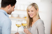 Young couple drinking white wine — Stock Photo