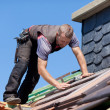 Stock Photo: Roofer next to chimney