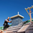 Roofer assembling tiles on a chimney — Stock Photo #28282427