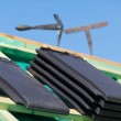 Close-up of tiles and tools on roof — Stock Photo #28282713