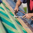Roofer welding the gutter — Stock Photo