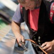 Stock Photo: Mature roofer applying weld into gutter