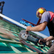 Stock Photo: Roofer using hand circular saw