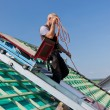 Roofer using the elevator — Stock Photo