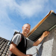 Roofer assembling parts of the dormer — Stockfoto
