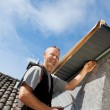 Roofer assembling parts of the dormer — Foto Stock