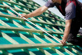 Close-up of a roofer measuring the roof beams — Stock Photo